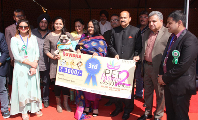 Chairperson PWWA, Bharti Vaid distributing prizes during Dog & Pet Fashion Show at Gulshan Ground in Jammu.
