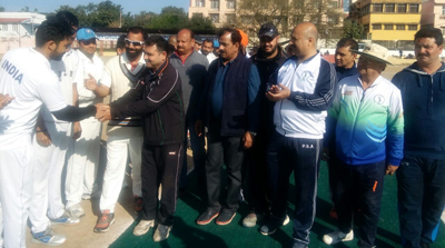Chief guest and other dignitaries interacting with players during inaugural function of Salute & Tribute Cricket Tourney at Parade ground in Jammu.