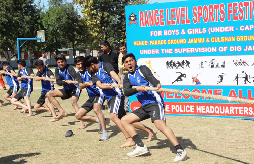 Tug-of War players sweating-it-out during Range Sports Festival at Gulshan Ground in Jammu.