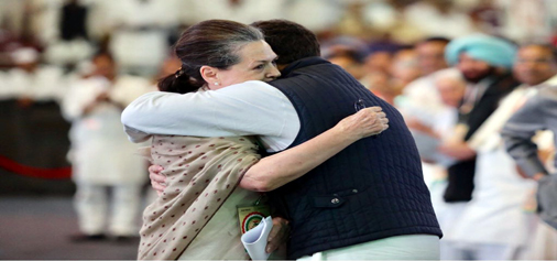 Congress president Rahul Gandhi hugs his mother and UPA chairperson Sonia Gandhi after addressing the party's plenary session, in New Delhi on Saturday. (UNI)