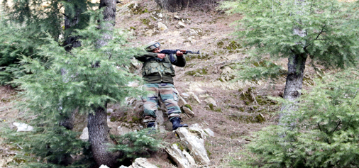 A jawan in action during encounter at Halmatpora, Kupwara on Tuesday. -Excelsior/Aabid Nabi