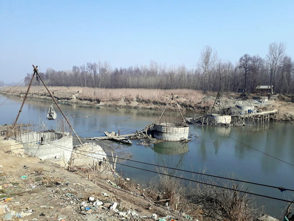 View of incomplete bridge over river Jhelum at Dogripora. -Excelsior/Younis Khaliq