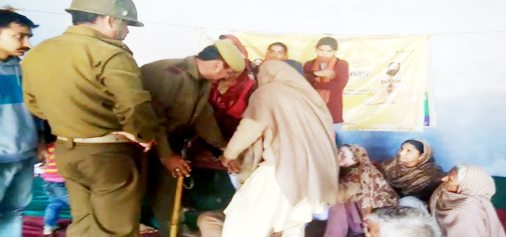 Policemen forcibly evicting Rassana villagers from Ram Leela Club, Koota on Wednesday.