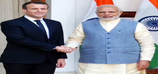 French President Emmanuel Macron being welcomed by Prime Minister Narendra Modi at Hyderabad House in New Delhi on Saturday. (UNI)
