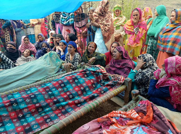 People wail over the bodies of Pakistan shelling victims at village Davitta in Balakote sector on Sunday. Another pic on page 6.