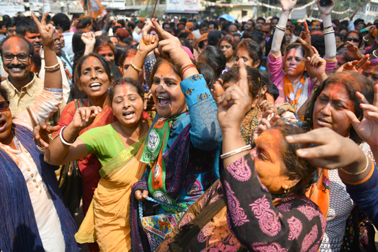 BJP supporters celebrating the party's victory in Tripura Legislative Assembly election, in Agartala on Saturday. (UNI)