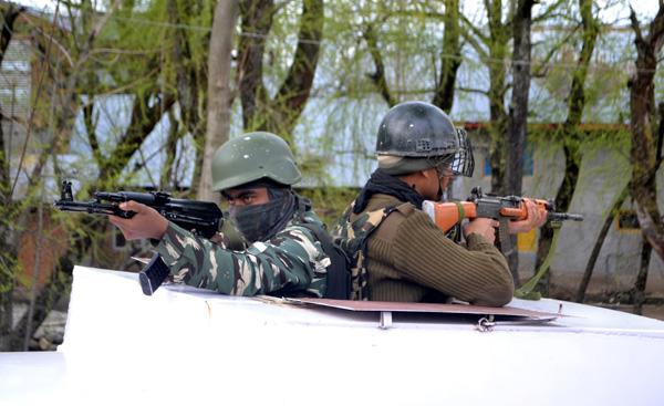 Troops during the gun battle at Dooru, Anantnag on Saturday. —Excelsior/Sajad Dar