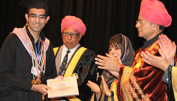 Governor N N Vohra awarding five Gold medals to Sachit Mahajan while Union Finance Minister Arun Jaitley and Chief Minister Mehbooba Mufti applause during 17th Convocation of JU on Sunday. —Excelsior/Rakesh