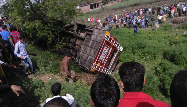 The badly damaged bus in a tragic road mishap at Mela Morh, Hiranagar on Sunday. Another pic on page 6. —Excelsior/Pardeep