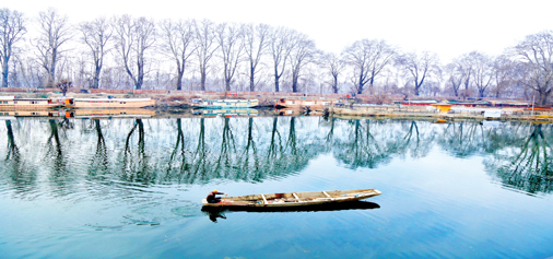 Chinar trees are reflected on the waters of Chuntkul on a warm winter day at Srinagar. -Excelsior/Shakeel