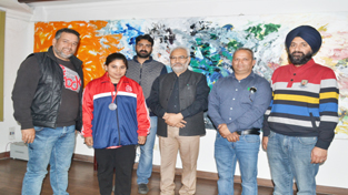 Ace Wushu player Kirti Sharma posing along with VC JU and other dignitaries in Jammu.
