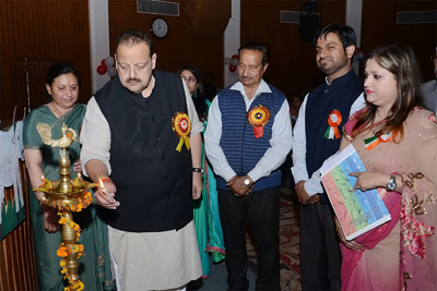 Provincial President National Conference Devender Singh Rana lighting ceremonial lamp during Annual Day celebration by Rain Drop Preschool in Jammu.