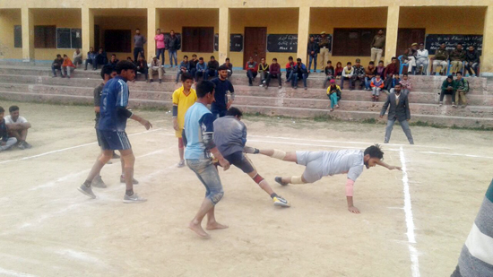 Catchers getting hold of raider during a Kabaddi match.
