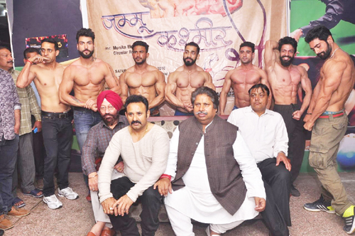 J&K Body Building team posing for a group photograph along with former Minister Raman Bhalla before being flagged off for Mr India Meet.
