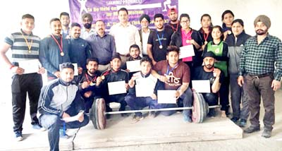 Weightlifters posing along with chief guest and other dignitaries after Competition in Jammu.