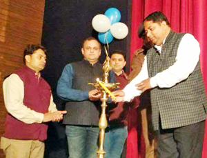 Chief guest Sat Sharma lighting the ceremonial lamp during Annual Day Function of Kidzee, Gandhi Nagar in Jammu.
