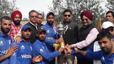 Jubilant players of LoC Club Poonch posing for a group photograph while receiving trophy.
