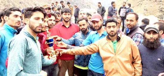 Winners of T20 Cricket Tournament posing along with the chief guest and other dignitaries at Drabshalla in Kishtwar.