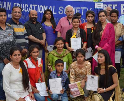 Students posing along with Minister for Health and Medical Education, Bali Bhagat during Annual Scholarship Distribution Function.