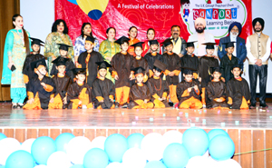Children posing for a group photograph during Annual Day function of Sanfort Preschool Miran Sahib in Jammu.