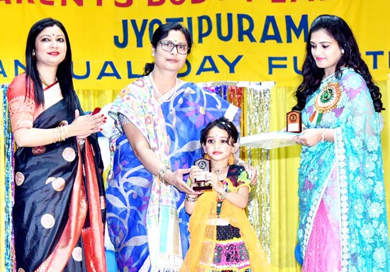 Child being felicitated by the dignitaries during Annual Day celebration at Play School Jyotipuram.