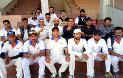 Teams of Aircel and Media posing for a group photograph at MA Stadium in Jammu.