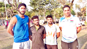 Wushu stars of J&K posing for a group photograph at MA Stadium in Jammu.