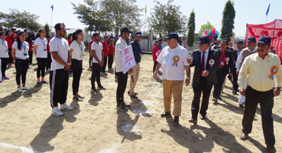 Students performing activity in presence of dignitaries during 2nd Abhishek Sports Meet at YCET in Jammu.