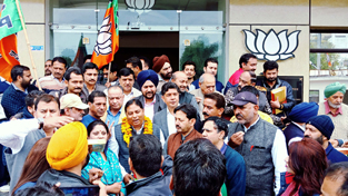 BJP leaders celebrating victory of party in two NE States at Jammu on Saturday.