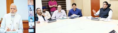 Chief Secretary B B Vyas presenting progress of SBM -Gramin to PM through video conferencing.