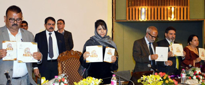 Chief Minister Mehbooba Mufti alongwith Ministers releasing catalogue of Buyer-Seller meet on Saturday.