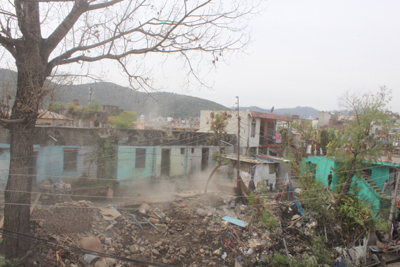 Administration carrying out anti-encroachment drive in Rajouri on Sunday.