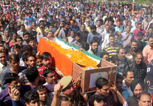 Sea of humanity taking body of martyr Deepak Kumar Thusoo for cremation at Jagti on Thursday. — Excelsior/Rakesh