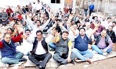 Ration dealers sitting on protest dharna outside CAPD office in Jammu on Monday. -Excelsior/Rakesh