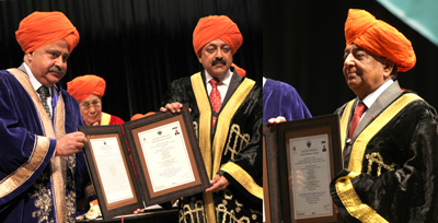 CUJ VC awarding Honoris Causa to Union Minister Dr Jitendra Singh and Ex Army Chief NC Vij while Dalai Lama looks on during the University Convocation on Sunday. — Excelsior/Rakesh
