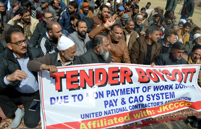Contractors protesting in Srinagar on Saturday. -Excelsior/Shakeel