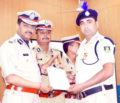 CRPF ADG VSK Kaumudi honouring a CRPF official in Jammu on Monday.