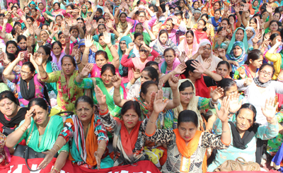 Anganwari workers and helpers staging a sit-in protest at Exhibition Ground, Jammu. -Excelsior/Rakesh