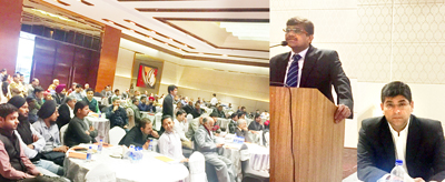 An expert briefing the traders on Market Outlook and Mutual Funds during a seminar in Jammu.