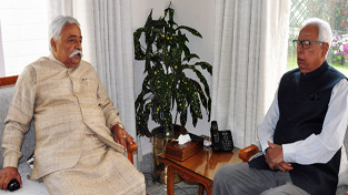 Governor NN Vohra and former Minister Ajay Sadhotra during a meeting at Raj Bhawan.