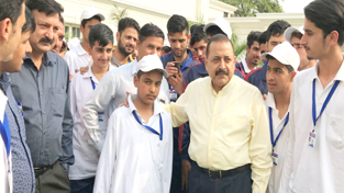 Union Minister Dr Jitendra Singh with a group of students from J&K at New Delhi on Tuesday.