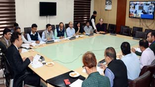 Minister for FCS&CA Ch Zulfkar Ali chairing a meeting at Jammu on Tuesday.