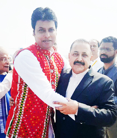 Newly sworn in Chief Minister of Tripura, Biplab Kumar Deb reaching out to Union Minister Dr Jitendra Singh for a jubilant hug, soon after the oath ceremony at Agartala on Friday.