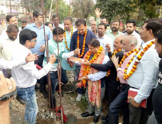 MLA, Sat Sharma laying foundation of community hall at Krishna Nagar on Wednesday.