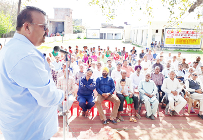 Minister for Industries, Chander Parkash Ganga addressing a public meeting at Samba on Saturday.
