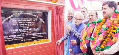 Minister for Public Works, Naeem Akhtar laying foundation stone of bridge at Utterbehni on Saturday.