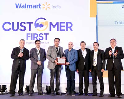 Kuntal Raj Jain, Director Duke Fashions (India) Ltd and other dignitaries displaying 'The Best Supplier' Award shield on Saturday.