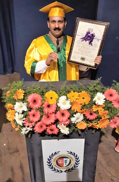 Raman Suri, a social worker from Jammu showing an honorary degree of Doctorate conferred by IVUP, Bengaluru.