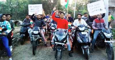 Members of Hindu Ekta Manch Samba and others during bike rally at Samba on Saturday. -Excelsior/Gautam