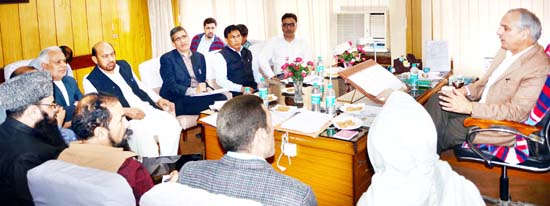 Minister for Revenue, AR Veeri chairing a meeting at Jammu on Thursday.